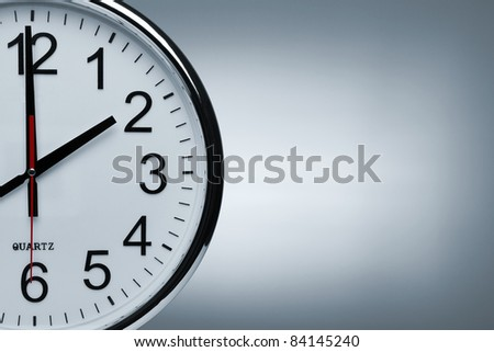 Close up of a clock isolated ob blue background with copy space