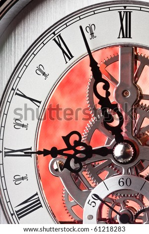 Close up of a Clock Showing Gears. Time is almost Nine-o-clock.