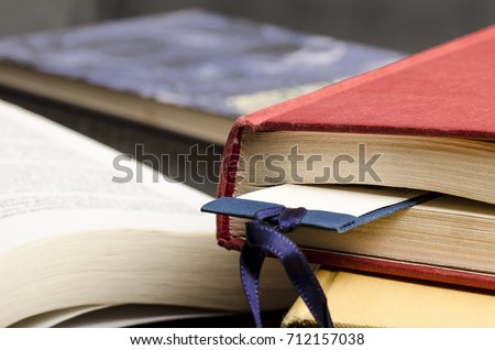 close up of a closed book with a bookmark. education. reading.