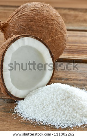 close up of a coconut and grounded coconut flakes