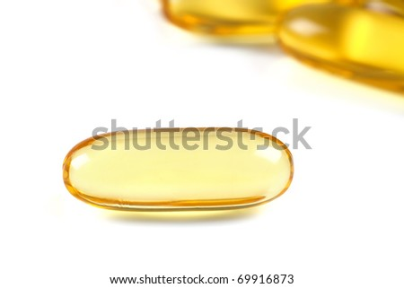 Close up of a  cod liver fish oil capsule, a nutritional supplement high in omega-3 fatty acids, EPA,  DHA, and  high levels of vitamin A and vitamin D.
