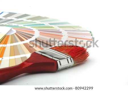 Close-up of a color palette and a brush on white background