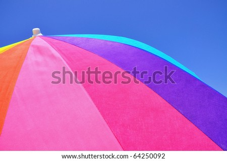 Close up of a colorful beach umbrella