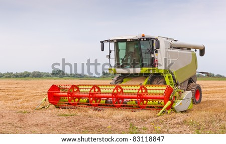 Close up of a combine after work at a Dutch field