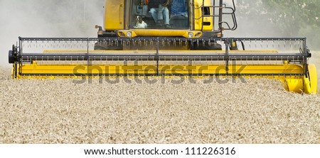 Close up of a combine harvester at work from the front