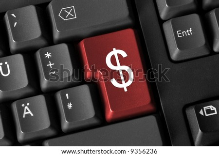 Close up of a computer keyboard. Red button showing a dollar sign.