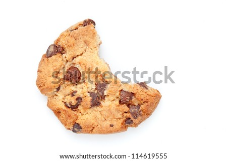 Close up of a cookie with a big part missing against a white background