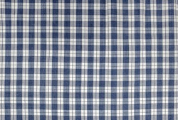 close up of a cotton fabric with checks and stripes