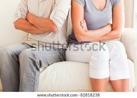 Close up of a couple arguing with the arms crossed