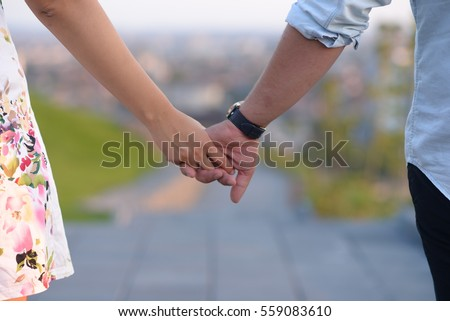 Close up of a couple holding hands