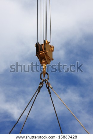 Close up of a crane hook lifting something