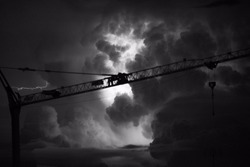 Close up of a Crane on a stormy night with lightning and thunderbolt in black and white