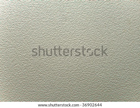 close up of a cream stucco wall