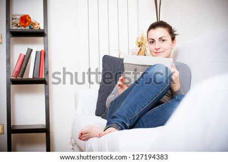 Close up of a cute woman using a tablet in her living room,Italy