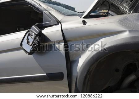 Close Up Of A Damaged Car At A Junkyard Ez Canvas