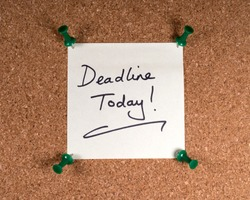 Close-up of a Deadline Today memo note pinned to a noticeboard.