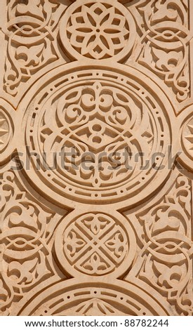 Close up of a decorated sandstone wall suitable for use as a background