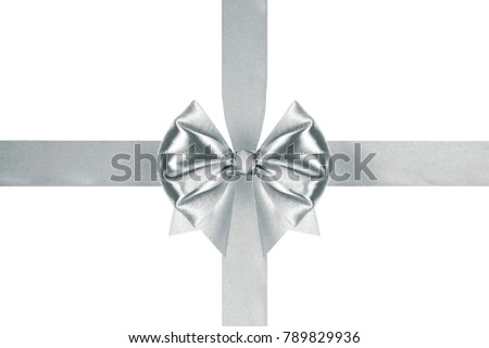 close up of a decorative silver ribbon bow with crosswise ribbons on white background #789829936