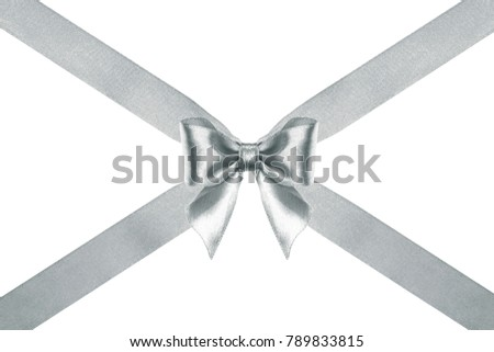 close up of a decorative silver satin ribbon bow with crosswise ribbons on white background #789833815