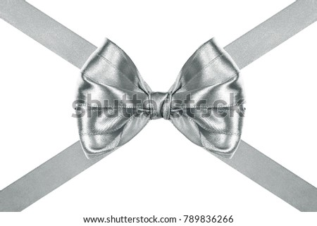close up of a decorative silver silk ribbon bow with crosswise ribbons on white background #789836266