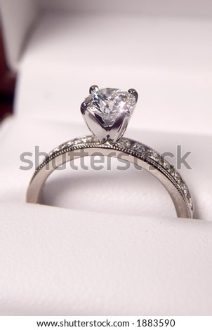 close up of a diamond engagement ring in the box