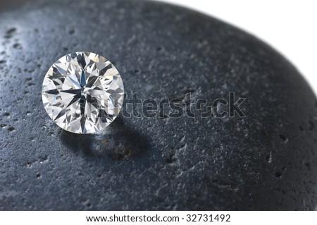 Close up of a diamond on the black stone