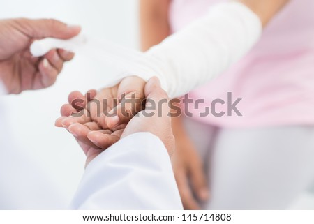 Close-up of a doctor's hand making a bandage for his patient