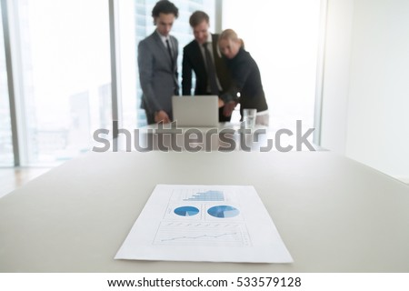 Shutterstock Close up of a document with charts, business people analyzing data of survey, understanding and targeting buyer personas, preparing presentation, free business analyst training courses online