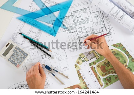 Close Up Of A Draftsman Drawing Diagram On Blueprints