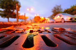 close up of a drainage sewer at sunset