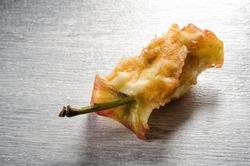 Close-up of a eaten stub apple