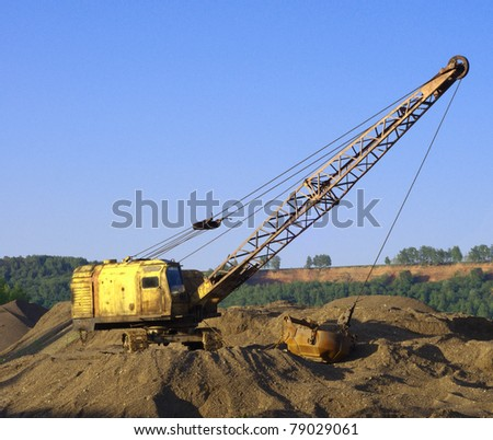 close up of a excavator on a macadam