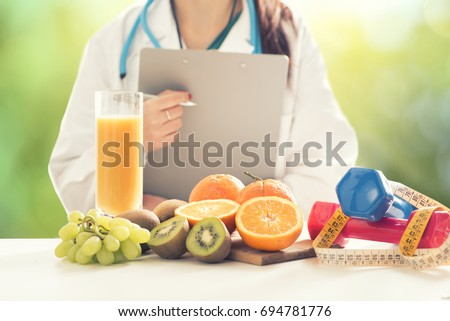 Close up of a Female Dietician With Fresh Vegetables and fruits