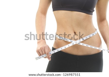 Close up of a female torso with a measuring tape.