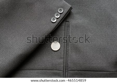 Close up of a few buttons on a business suit coat an euro coin #465514859