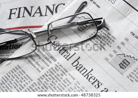 close up of a financial newspaper pages and headlines - stock photo