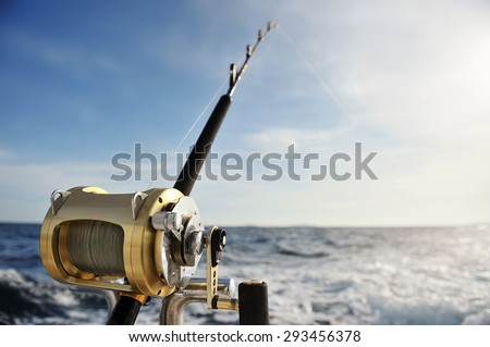 Close-up of a fishing reel on the boat