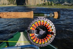 Close up of a fly fishing rod, reel and fly line, in the late evening sun