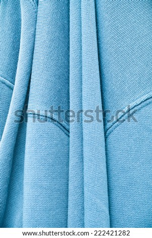 Close up of a folded hanging cotton jumper