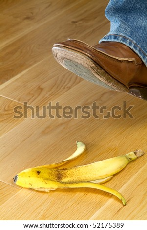 Close up of a foot about to tread on banana skin