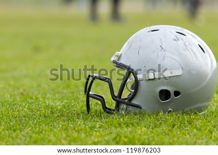 Close up of a football helmet on the grass