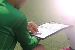 Close up of a football / soccer magnetic coach board with game plan (on a bench at the soccer field)