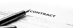 Close-up of a fountain pen on docunent contract. Legal contract signing, buy sell real estate contract agreement sign on document paper with black pen