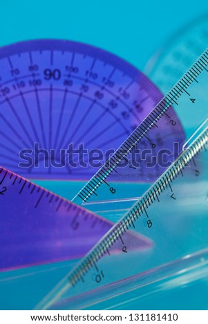 close up of a geometry set showing 45\'set square,60\