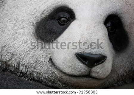 close up of a giant panda statue