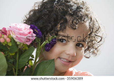 Close-up of a girl holding a bouquet of flowers