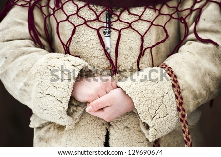 Close up of a girl's hands dressed in traditional Romanian wear