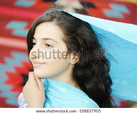 Close-up of a girl with scarf
