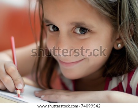 Close up of a girl working on her art project at home