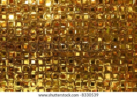 Close up of a glass blocks window with golden light colors.